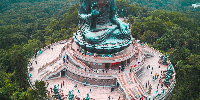 aerial photography of people walking around Bhumishparsha Mudra monument